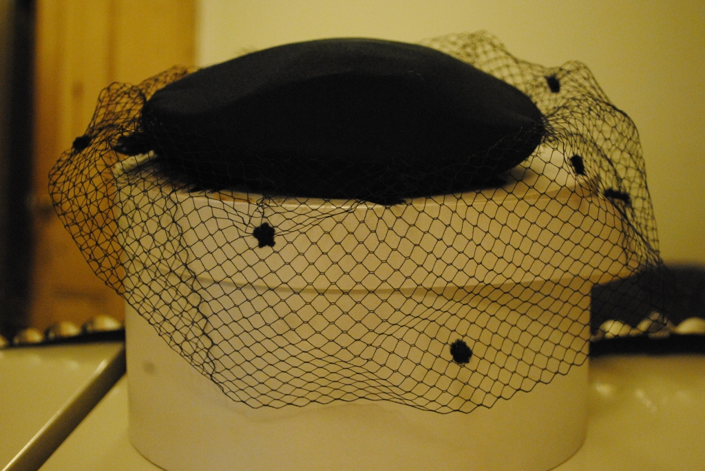 hat with a veil.