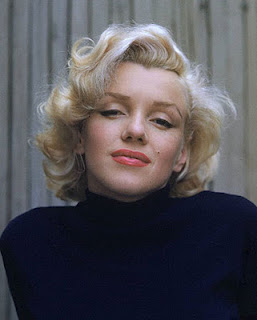 Marilyn Monroe in a roll neck sweater.