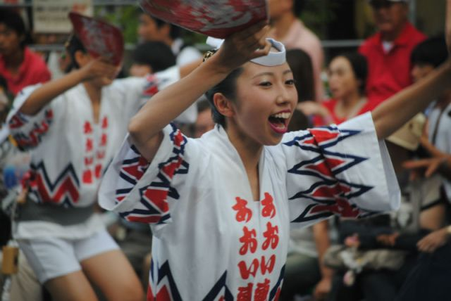 Woman dancing at Awa Odori in Tokushima