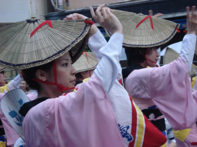 A woman dancing in traditional dress at the Awa Odori in Takushima, Japan.