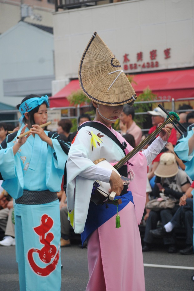 Woman playing the shamisen at Awa Odori Tokushima, Japan.
