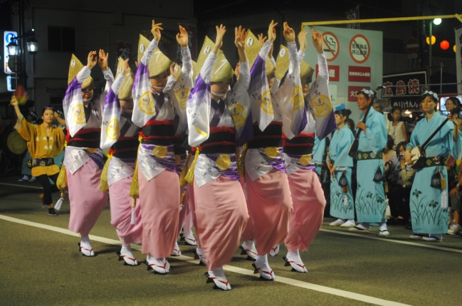Woman dancing Awa Odori in formation, Tokushima, Japan.