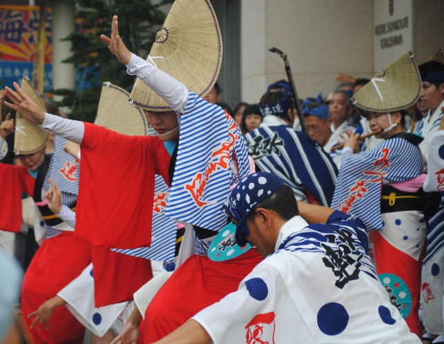 Women and men dance at the Awa Odori Festival.