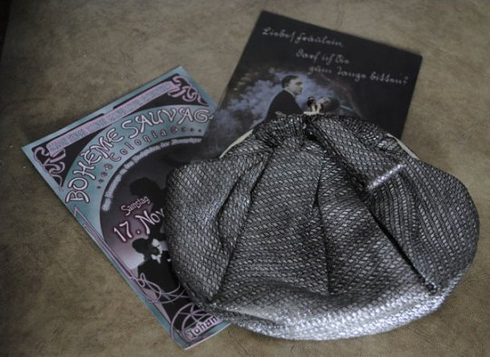 1920s style silver purse with Boheme Sauvage tickets